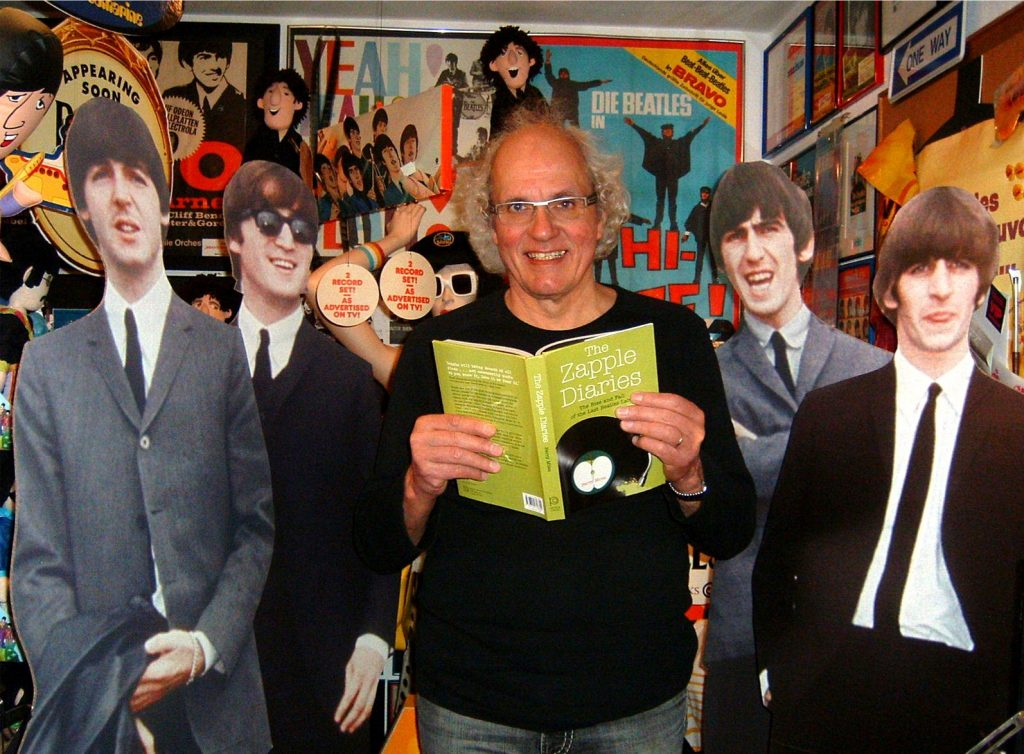 Harold Krämer proudly displays his copy of The Zapple Diaries in The Smallest Beatles Museum in the World, Siegen, Germany