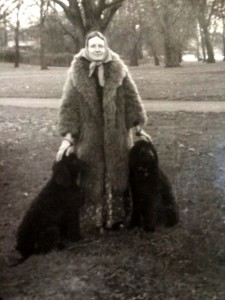 Rose Knox-Peebles, attended by dogs, wearing the fur coat given to her by Anna Kavan